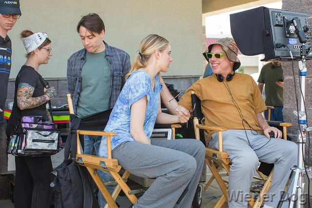 Director Todd Solondz (far right) talks with Greta Gerwig on the set of Wiener-Dog. - COURTESY OF IFC FILM