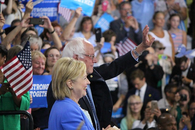 Hillary Clinton and Bernie Sanders campaign together Tuesday morning in Portsmouth, N.H. - PAUL HEINTZ