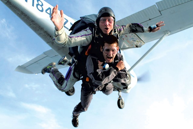 Ole Thomsen (rear) doing a recent tandem jump with a skydiving student - COURTESY OF OLE THOMSEN