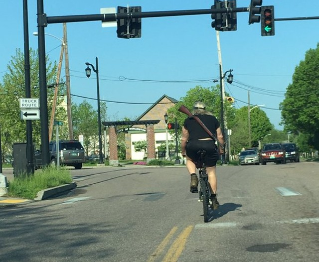A cyclist identified as Malcolm Tanner at North Winooski and Riverside Avenues in May. - COURTESY: DAN BARNES