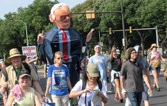 Los Angeles artist Alex Schaefer marched inside his 10-foot-tall Big Bernie creation. - KEVIN J. KELLEY