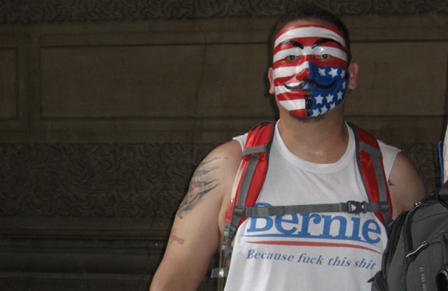 A Bernie bro at Philadelphia City Hall wearing a T-shirt with a memorable logo. - KEVIN J. KELLEY