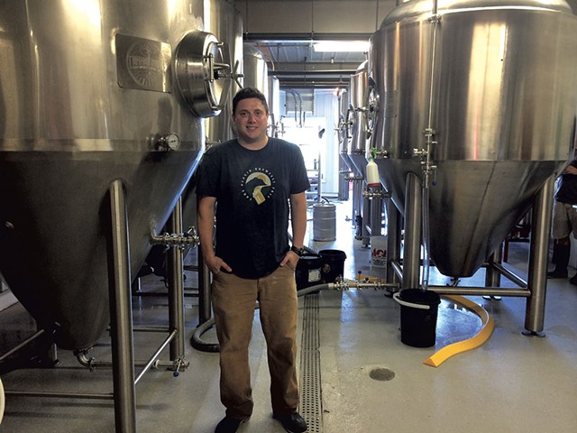 Christian Weber in the tank room at Common Roots Brewing Company - JULIA CLANCY