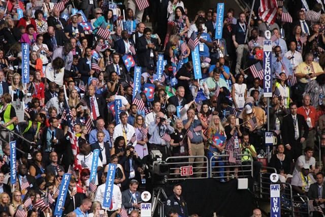 Vermont delegates watch Hillary Clinton accept the Democratic presidential nomination Thursday night in Philadelphia. - PAUL HEINTZ
