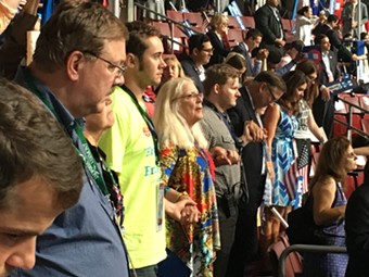 Vermont delegates hold hands Thursday night during the benediction at the Democratic National Convention in Philadelphia. - PAUL HEINTZ