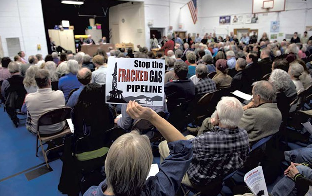A crowded meeting on the Vermont Gas pipeline project at Shoreham Elementary School in 2014 - FILE: CALEB KENNA