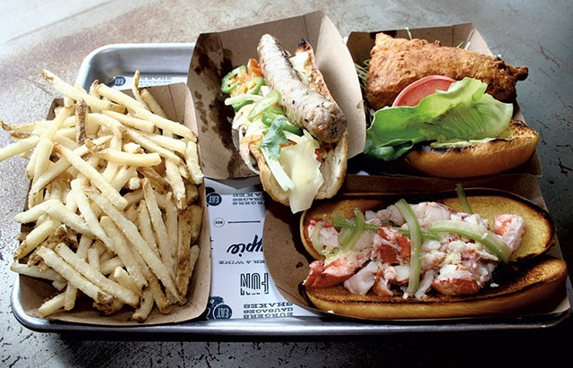 French fries, the Vietnamese sausage, fried chicken sandwich and lobster roll at Honeypie - SUZANNE PODHAIZER