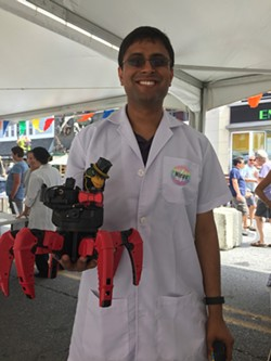 Nirav Shah, of Burlington's Laboratory B, with Fluffy the laser-shooting robot