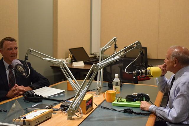 Lt. Gov. Phil Scott (left) and retired businessman Bruce Lisman settle in for a debate at Vermont Public Radio. - TERRI HALLENBECK