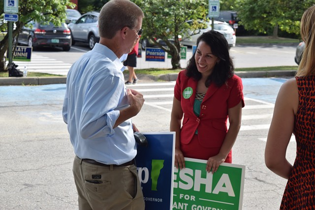 House Speaker Shap Smith (D-Morristown) and Rep. Kesha Ram (D-Burlington) chat Tuesday as they campaign outside the Burlington Electric Department polling station. - TERRI HALLENBECK