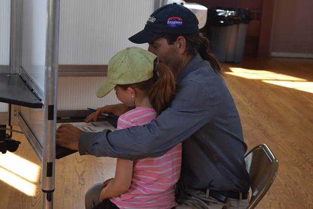 Sen. David Zuckerman (P/D-Chittenden) votes Tuesday in Hinesburg with daughter Addie. - TERRI HALLENBECK