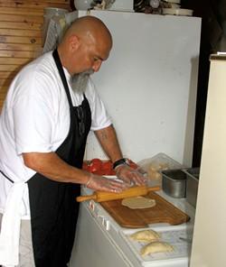 Manuel Aguilera making empanadas - ROBERT C. JENKS