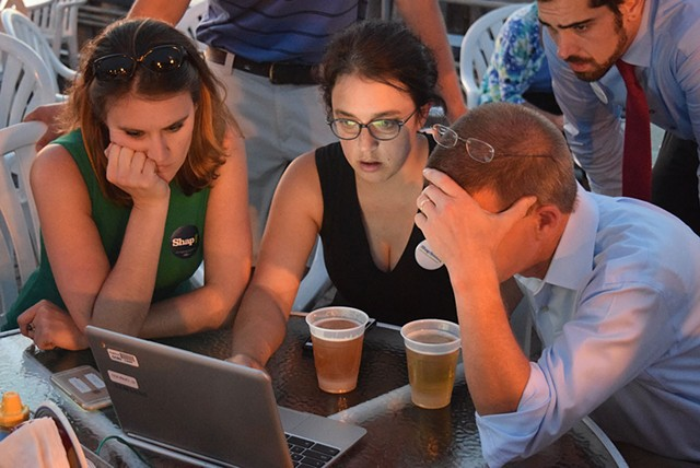 House Speaker Shap Smith reviews election results last Tuesday at Breakwater Café & Grill with campaign manager Erika Wolffing (left) and supporter Candace Morgan. - TERRI HALLENBECK