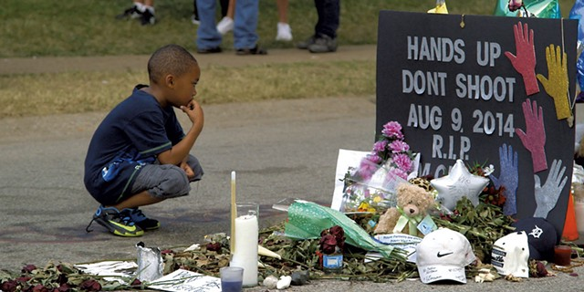 A young boy at the Michael Brown memorial site in Ferguson, Mo. - COURTESY OF VANISH FILMS