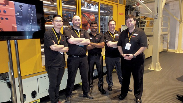 Dennis Thibault, second from left, with coworkers - COURTESY OF PENNY THIBAULT