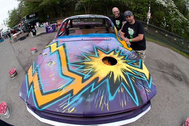 """Jason """"Tooth"""" Toothaker and Brian Clark with Big Heavy World's demolition derby car"""