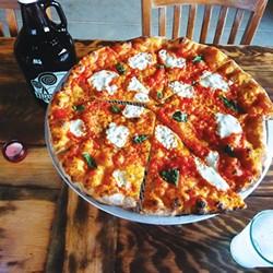 A Folino's pizza - CORIN HIRSCH
