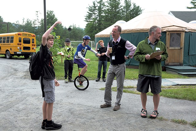 Sharon Academy head of school Michael  Livingston, second from right, learns about yo-yoing from seventh grader Elliot Tonks - JAMES M. PATTERSON