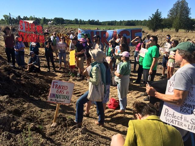 Protesters listening to a speaker. - RACHEL JONES