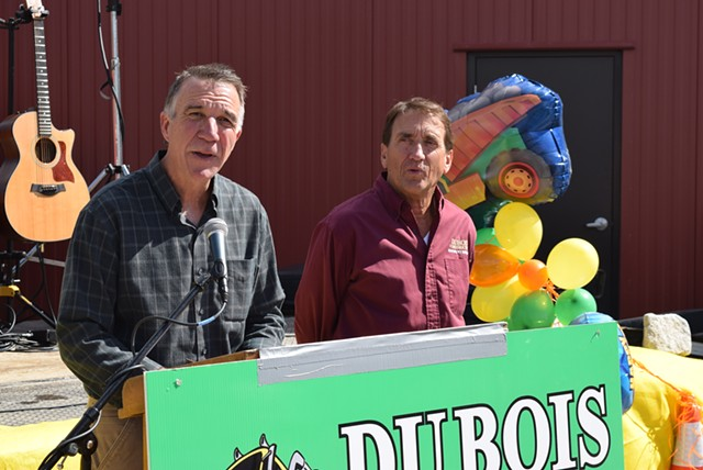 Republican gubernatorial candidate Phil Scott (left) announces he will sell his share in DuBois Construction if he's elected governor, as co-owner  Don DuBois looks on Saturday outside the company's Middlesex offices. - TERRI HALLENBECK