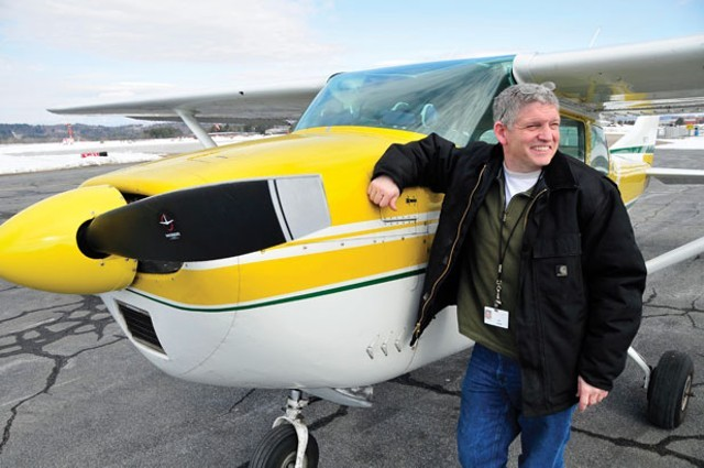 State aviation program administrator Guy Rouelle with Vermont's Cessna 182 - FILE: JEB WALLACE-BRODEUR