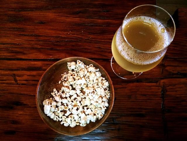 Draft of cider and herbed popcorn at Shacksbury Cider's tasting room - JULIA CLANCY