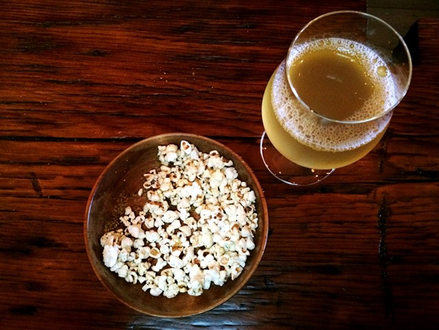Draft of cider and herbed popcorn at Shacksbury Cider's tasting room - JULIA CLANCY