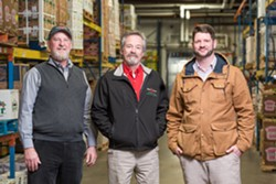 Black River Produce founders Steve Birge and Mark Curran with President Sean Buchanan - COURTESY OF OLIVER PARINI