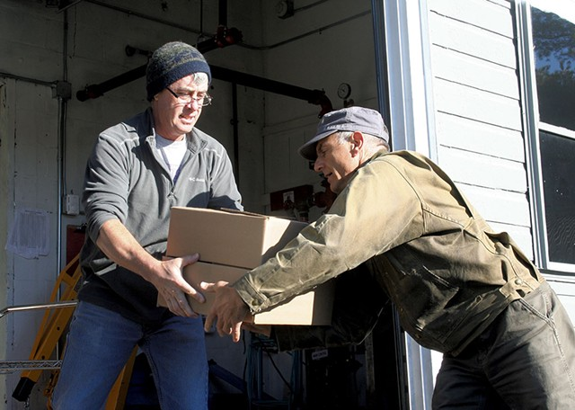 Chef and farmer Joe Buley handing off - a soup order to Gregory Georgaklis - SUZANNE PODHAIZER