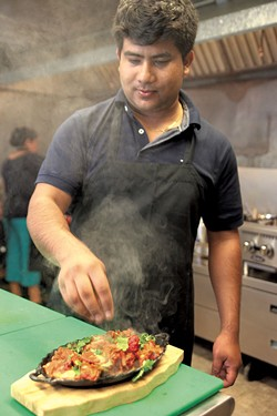 Jeetan Khadka with tandoori chicken - MATTHEW THORSEN