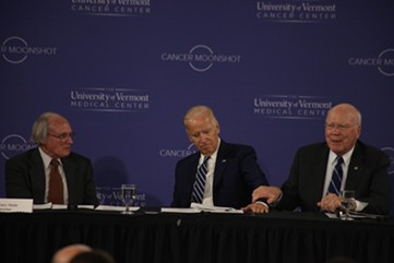 Sen. Patrick Leahy holds Vice President Joe Biden's arm Friday morning during a roundtable at the University of Vermont. - MATTHEW THORSEN