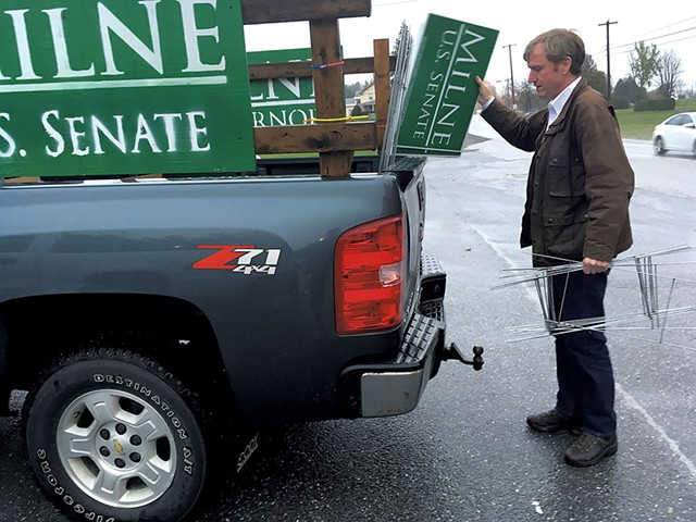 Scott Milne unloading campaign signs at a  diner in Pittsford - MARK DAVIS
