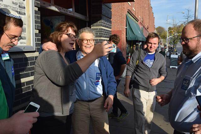 Sen. Al Franken (D-Minn.) posing for a selfie - TERRI HALLENBECK