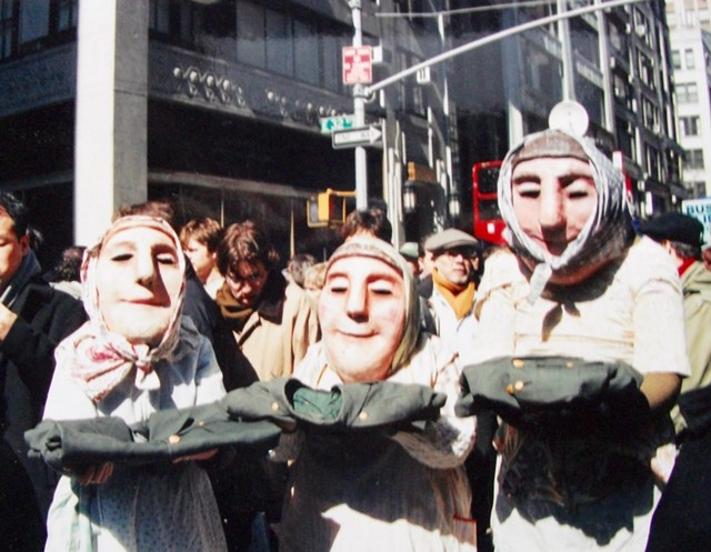 Llu Mulvaney-Stanak (left) with parents Joelen Mulvaney and Ed Stanak as Bread and Puppet Theater washerwomen in a 2002 New York City parade against the Iraq war. - COURTESY PHOTO