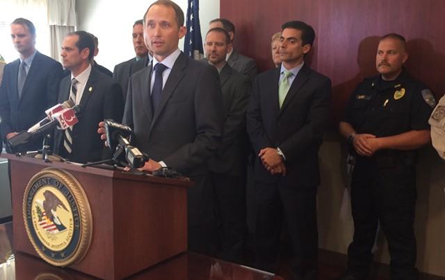 U.S. Attorney Eric Miller, at podium - FILE: MARK DAVIS