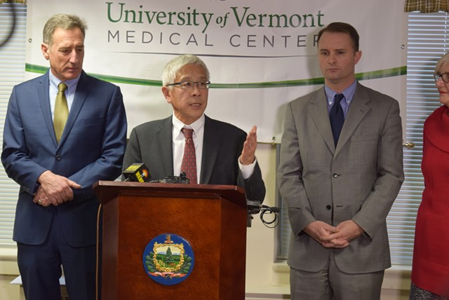 Dr. Harry Chen (center) at a 2015 press conference. - TERRI HALLENBECK