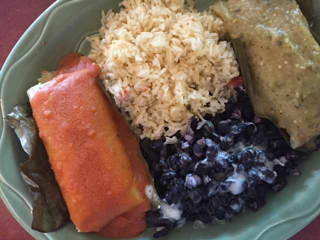 Salvadoran tamales (beef, left; chicken, right), rice and beans - HANNAH PALMER EGAN