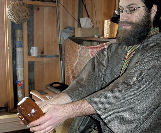 Ben Youngbaer doing a Japanese tea ceremony at Setting Sun Tea Hut - SUZANNE PODHAIZER