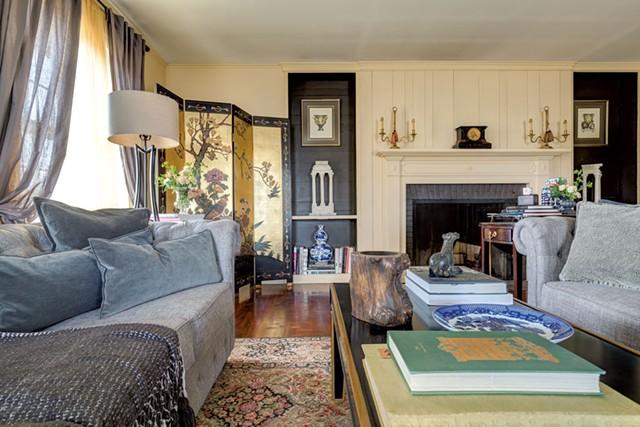 Kory Rogers and Jonathan Mikulak strike a suitably elegant tone in their apartment at Shelburne Farms. - CALEB KENNA