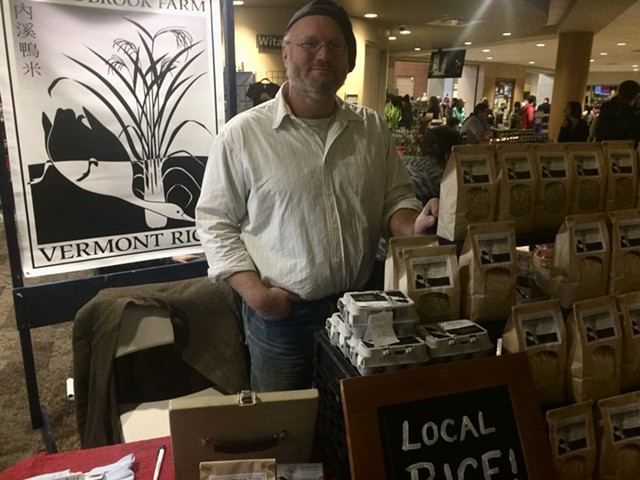 Erik Andrus sells his rice and duck eggs at the Burlington Farmers Market - SUZANNE PODHAIZER