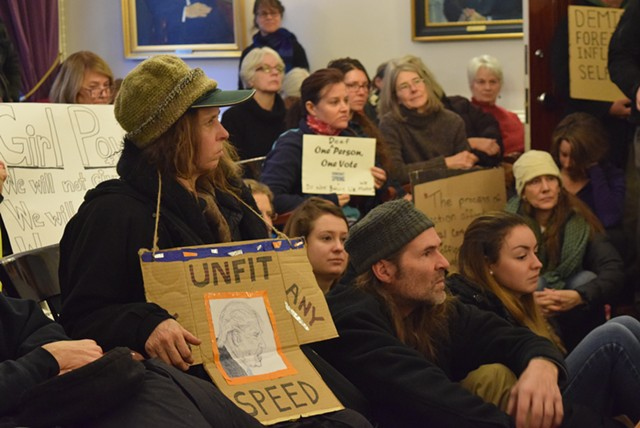 Protesters watch Vermont's electors certify the state's three electoral votes for Democrat Hillary Clinton. - TERRI HALLENBECK
