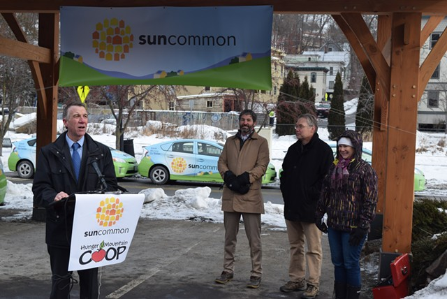Gov. Phil Scott (left) joins SunCommon cofounder (second from left) James Moore at a press conference Monday. - TERRI HALLENBECK