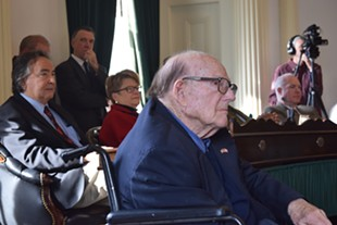 Bill Doyle listens as senators honor him, while Gov. Phil Scott looks on. - TERRI HALLENBECK