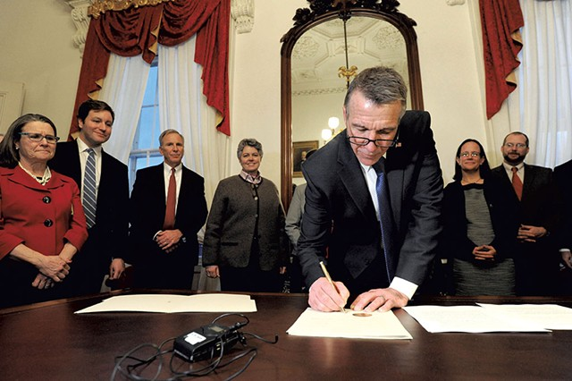 "Gov. Phil Scott signing an executive order calling on state government to make Vermont more ""affordable"" - JEB WALLACE-BRODEUR"