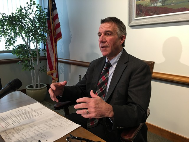 Gov. Phil Scott lays out the sale of his construction company. - JOHN WALTERS