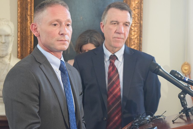 Commerce Secretary Michael Schirling (left) and Gov. Phil Scott talk Tuesday about the proposed agency reorganization.