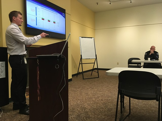 Burlington police crime analyst Eric Fowler presents a use-of-force study in the Fletcher Free Library. - MARK DAVIS