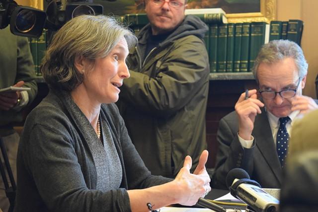 Education Secretary Rebecca Holcombe talks to the Senate Education Committee on Tuesday as Sen. Chris Bray (D-Addison) looks on. - TERRI HALLENBECK