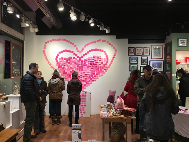 """Visitors place notes on the """"Wall of Love"""" at Frog Hollow - SADIE WILLIAMS"""