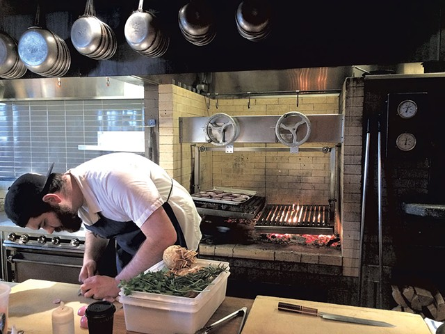 Avery Buck prepping for dinner service - SUZANNE PODHAIZER